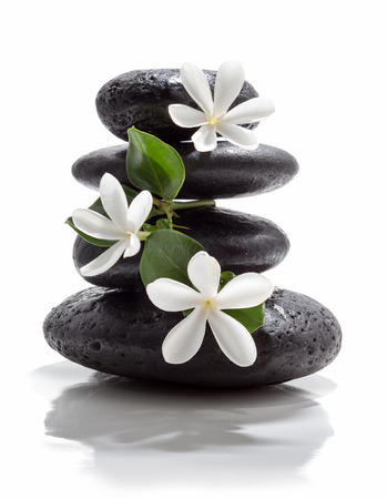 white stone: tiare flowers and tower black stone spa  Stock Photo
