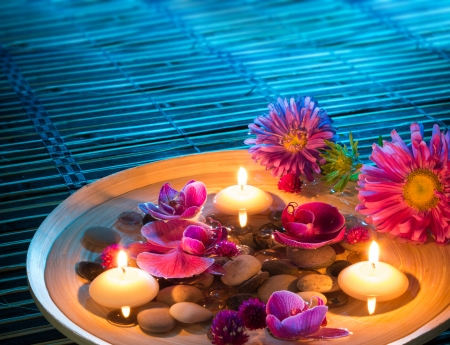daisys: dish spa with floating candles, daisys, orchid on mat