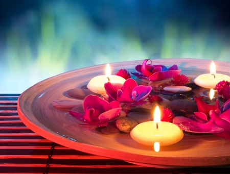 floating: dish spa with floating candles, orchid, in garden