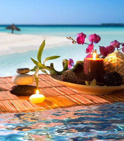stones in water: Popurr�, bowl, candles, cinnamon, on tropical water