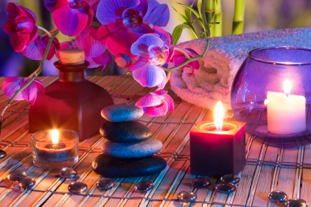 violet flowers: candles, oil, potpourri, stones, glass dots, orchids and bamboo  Stock Photo