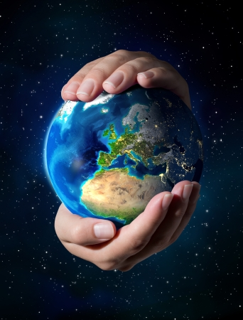 our: earth in the hands - Europe - universe background  Stock Photo