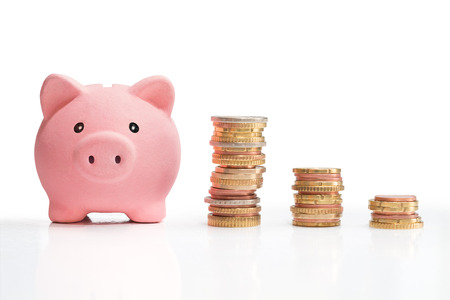 bank rate: money saving and money tower  Stock Photo