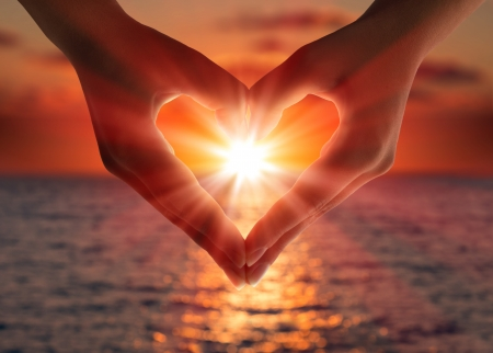 sunset in heart hands Stock Photo
