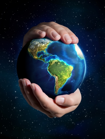 terrestrial globe: earth in the hands - Universe background - USA