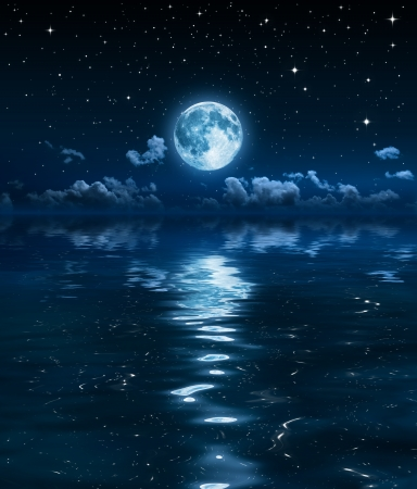 moon night: super moon and clouds in the night on sea  Stock Photo
