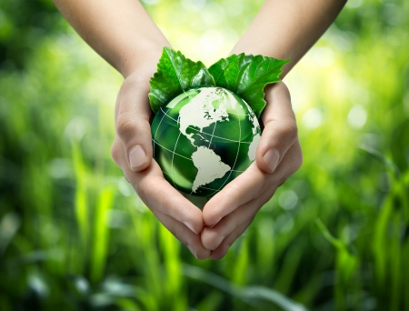 terrestrial globe: Green planet in your heart hands - usa - environment concept
