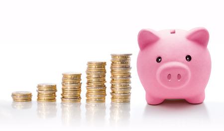white piggy bank: Piggy bank with euro coin stacks - concept of increase