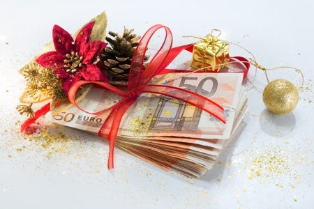 christmas profits: pack of euro for the Christmas gift with decorations  Stock Photo