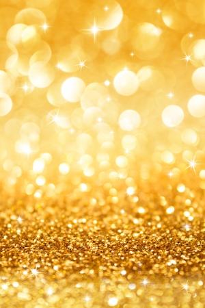 garish: golden glitter and stars for christmas background vertical