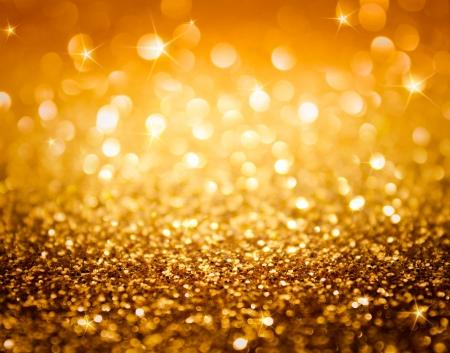 glitter gloss: golden glitter and stars for christmas background