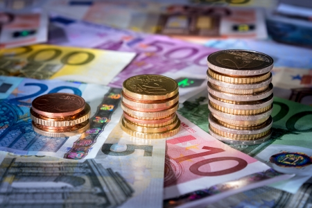 income market: coins chart on euro banknotes Stock Photo