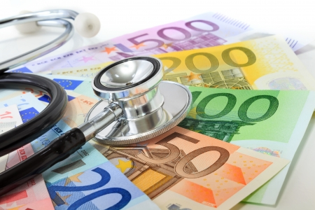 doctor with money: European currency sick concept  stethoscope on euro banknotes  Stock Photo