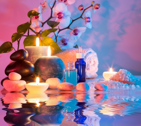 preparation for bath massage in chromotherapy - cyan red  photo