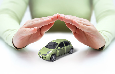 insure: safety your car - hands covering