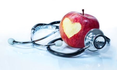 concept of love for health - apple with stethoscope  Stock Photo