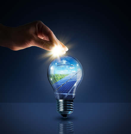 energy savings: invest in solar energy - concept - sun in bulb - piggybank