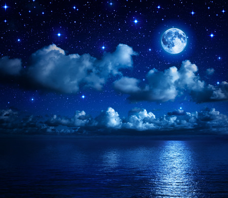 super moon in starry sky with clouds and sea  photo