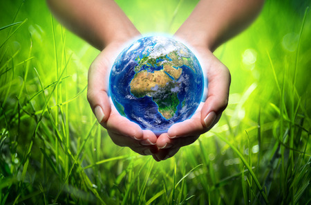 save the earth: earth in hands - grass - environment concept - Europe