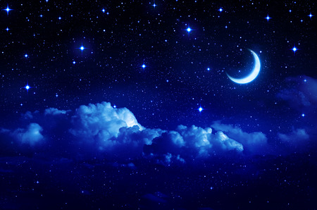 starry sky with half moon in scenic cloudscape  Фото со стока