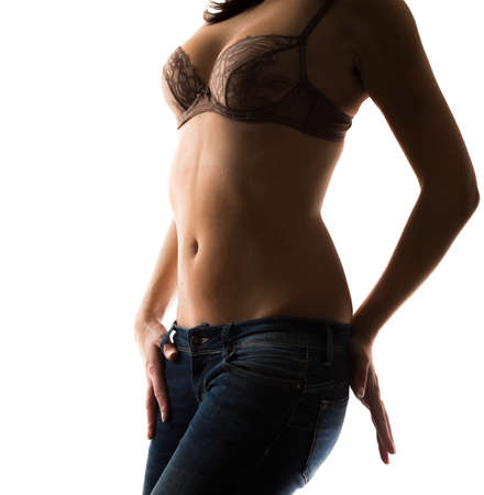 silhouette of sensual girl in bra and jeans  photo