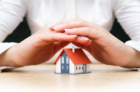 home safety: house covered of woman hands Stock Photo