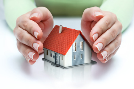 protect home: protect and insurance real estate concept - home covered