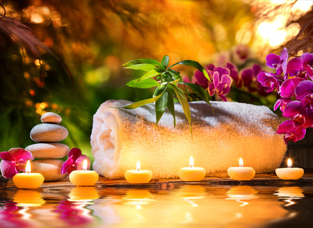spa candles: spa massage in garden - candles and water