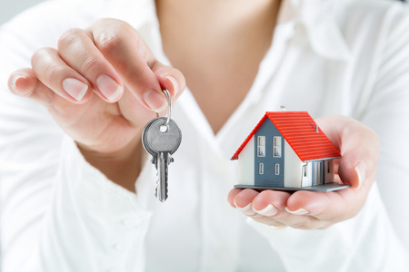 property agent: real estate agent handing over keys to home  Stock Photo