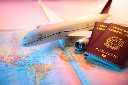 travel destination: trip in America - passport, airplane and map of world