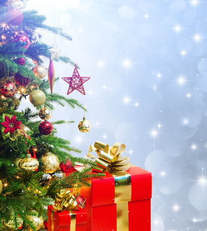 closeup of christmas tree decorated with red Christmas presents photo