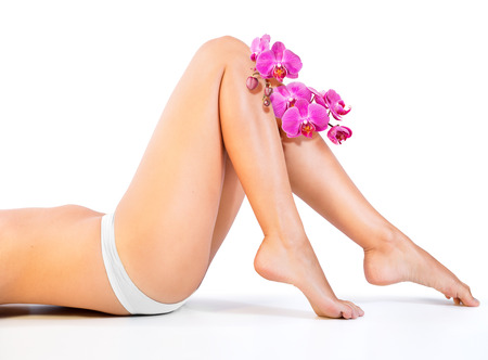 legs and beautiful orchids photo