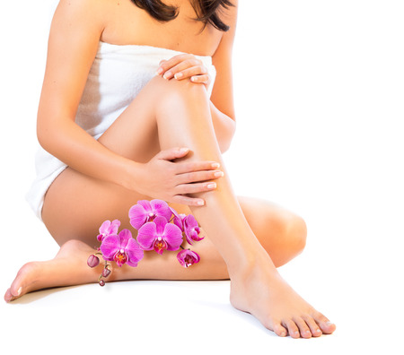 depilation: legs and body care with orchids Stock Photo