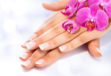 french: French manicure with orchids Stock Photo