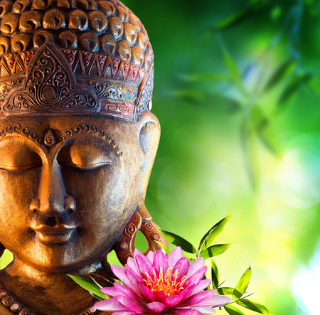buddha face: Oriental background with buddha, lily and bamboo Stock Photo