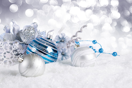 blue christmas balls with decorations on snow Stockfoto
