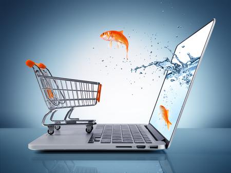 goldfish jump: goldfish in cart - e-commerce concept