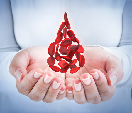 blood cells in hands - shaped blood drop - donation concept Stock Photo