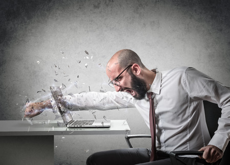 angry businessman: explosion of anger Stock Photo