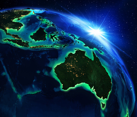 aus: land area in Australia and Indonesia the night