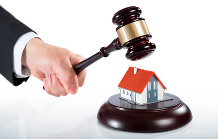 bankrupt: gavel on house  auction of real estate