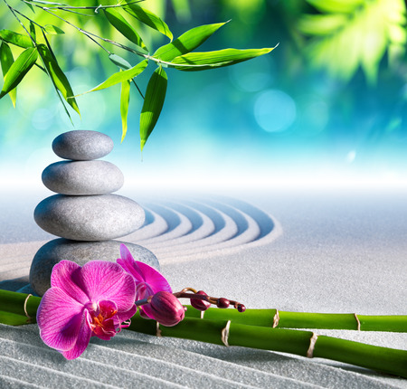 zen garden: sand orchid and massage stones in zen garden Stock Photo