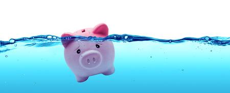 Piggy bank drowning in debt  savings to risk Foto de archivo