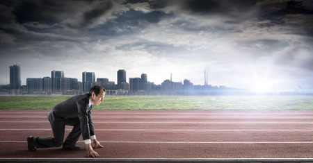 business start  businessman on track ready for sprint photo