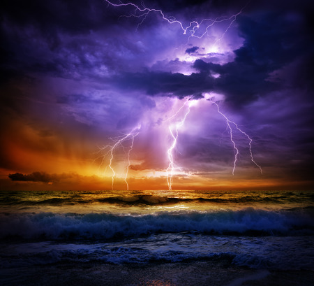 storm clouds: lightning and storm on sea to the sunset - bad weather