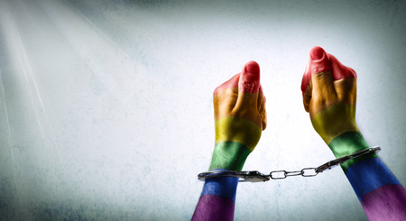 oppression: handcuffed hands - denunciation of the criminalization of homosexuality Stock Photo