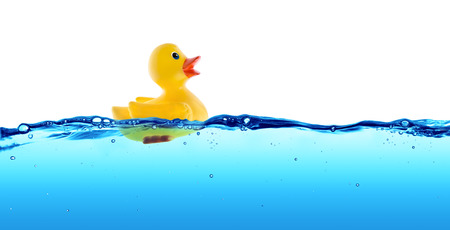 blue wave: Rubber duck float in water Stock Photo