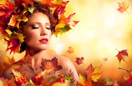 Autumn Woman Portrait - Beauty Fashion Model Girl - With Red Leaves photo