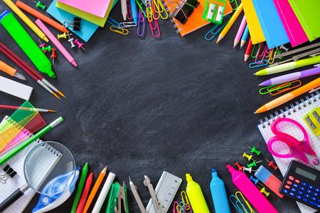 office supplies: School stationery on blackboard framing - back to School