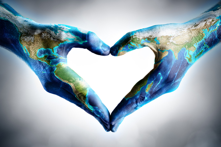 globe people: earths day celebration - hands shaped heart with world map
